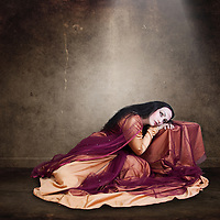 Beautiful Young Woman resting with long dark hair