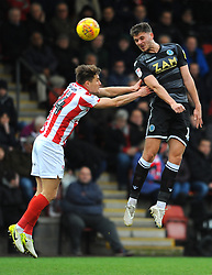 Charlie Raglan of Cheltenham Town and Harry Smith of Macclesfield Town compete for the highball- Mandatory by-line: Nizaam Jones/JMP- 26/01/2019 - FOOTBALL - LCI Rail Stadium -Cheltenham, England - Cheltenham Town v Macclesfield Town - Sky Bet League Two
