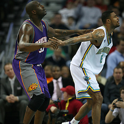 Tyson Chandler #6 for the Hornets gets position on Shaquille O'Neal #32 on February 26, 2008 at the New Orleans Arena in New Orleans, Louisiana. The New Orleans Hornets defeated the Phoenix Suns 120-103.