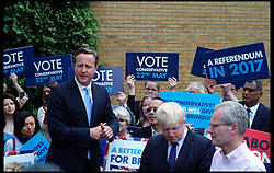 David Cameron and Boris Johnson campaigning for the European elections in the car park at the Conservative Association HQ in Ealing West London, United Kingdom, Wednesday, 21st May 2014.  Picture by Andrew Parsons / i-Images
