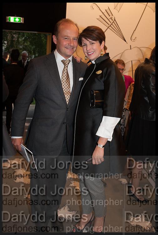 GUY GOODFELLOW (L) & DAVINA MALLINCKRODT (R) at the preview of LAPADA Art and Antiques Fair. Berkeley Sq. London. 23 September 2014.