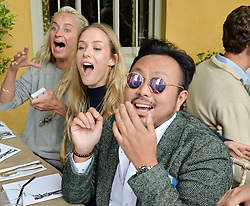Kalita Al Swaidi, Hum Fleming and Ethan Koh at Young Guns raising money for the fight against breast cancer trough Cancer Research UK held at EJ Churchill Shooting School followed by lunch at West Wycombe Park, England. 23 September 2017.