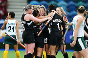 Jordan Grant of New Zealand is mobbed by teammates after scoring a goal during the bronze medal match between New Zealand and South Africa. Glasgow 2014 Commonwealth Games. Hockey, Bronze Medal Match, Black Sticks Women v South Africa, Glasgow Green Hockey Centre, Glasgow, Scotland. Saturday 2 August 2014. Photo: Anthony Au-Yeung / photosport.co.nz