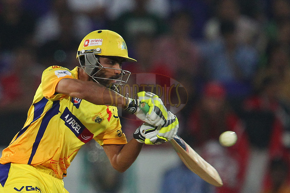 Ravindra JADEJA of the Chennai Superkings  during the second semi final match of the Oppo Champions League Twenty20 between the Kings XI Punjab and the Chennai Superkings held at the Rajiv Gandhi Cricket Stadium, Hyderabad, India on the 2nd October 2014<br /> <br /> Photo by:  Ron Gaunt / Sportzpics/ CLT20<br /> <br /> <br /> Image use is subject to the terms and conditions as laid out by the BCCI/ CLT20.  The terms and conditions can be downloaded here:<br /> <br /> http://sportzpics.photoshelter.com/gallery/CLT20-Image-Terms-and-Conditions-2014/G0000IfNJn535VPU/C0000QhhKadWcjYs