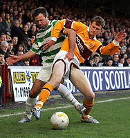 Photo: Paul Thomas.<br /> Motherwell v Glasgow Celtic. Bank of Scotland Scottish Premier League. 30/12/2006.<br /> <br /> Maciej Zurawski (L) of Celtic tackles Mark Reynolds, doing so he pulls up Reynolds pants to reveal a bit too much!!