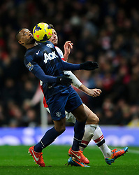 Man Utd Defender Patrice Evra (FRA) is challenged by Arsenal Forward Olivier Giroud (FRA) - Photo mandatory by-line: Rogan Thomson/JMP - 07966 386802 - 12/02/14 - SPORT - FOOTBALL - Emirates Stadium, London - Arsenal v Manchester United - Barclays Premier League.