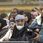 Muslim man in the crowd atEid in the Square, Trafalgar Square, London<br />