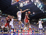 Oklahoma Sooners guard Buddy Heild (3) drives around Kansas Jayhawks center Jeff Withey (5) for a basket during the second half at Allen Fieldhouse. Kansas defeated Oklahoma 67-54.