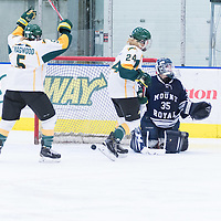 2nd year forward Jaycee Magwood (5) of the Regina Cougars celebrates as 5th year defender Alexis Larson's (22) puck fins the net during the Women's Hockey home game on October 8 at Co-operators arena. Credit: Arthur Ward/Arthur Images