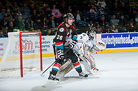 KELOWNA, CANADA - NOVEMBER 6: Cole Linaker #26 of the Kelowna Rockets looks for the pass in front of Red Deer Rebels goaltender Taz Burman on NOVEMBER 6, 2013 at Prospera Place in Kelowna, British Columbia, Canada.   (Photo by Marissa Baecker/Shoot the Breeze)  ***  Local Caption  ***