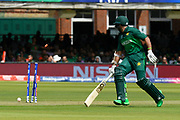 Imam-ul-Haq of Pakistan gets home to avoid a run out as a direct hit smashes into the stumps during the ICC Cricket World Cup 2019 match between Pakistan and Bangladesh at Lord's Cricket Ground, St John's Wood, United Kingdom on 5 July 2019.