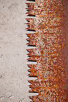 Rusty old saw blade on concrete in the Valle Onsernone in  Ticino, Southern Switzerland.