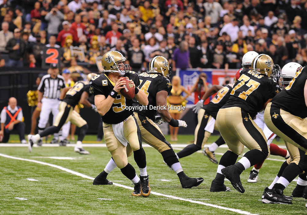 16 January 2010:  New Orleans Saints quarterback Drew Brees (9) looks to pass during a 45-14 win by the New Orleans Saints over the Arizona Cardinals in a 2010 NFC Divisional Playoff game at the Louisiana Superdome in New Orleans, Louisiana.