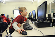 Avery School first-grader Eamonn Stephens works on an animation project during the afterschool program, March 4, 2014.<br /> Wicked Local staff photo/Kate Flock