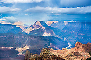 A grand storm shot from Lipan Point.   Weather brings the Grand Canyon alive with light and shadow, clouds and odd rainbows.  Beyond the canyon butte, there is the oddest of rainbow color.