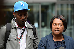 Theresa May and Doreen Lawrence Meeting.<br /> The campaigner and mother of murdered teenager Stephen Lawrence - Doreen Lawrence with son Stuart Lawrence after a private meeting with the Home Secretary Theresa May, following allegations that the Metropolitan Police engaged in a smear campaign against her and her family's supporters, at the Home Office, <br /> London, United Kingdom <br /> Thursday, 27th June 2013<br /> Picture by Andrew Parsons / i-Images