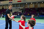 Jerzy Janowicz of Poland while Tenis 10 ( tennis event for children ) during the BNP Paribas Davis Cup 2014 between Poland and Croatia at Torwar Hall in Warsaw on April 5, 2014.<br /> <br /> Poland, Warsaw, April 5, 2014<br /> <br /> Picture also available in RAW (NEF) or TIFF format on special request.<br /> <br /> For editorial use only. Any commercial or promotional use requires permission.<br /> <br /> Mandatory credit:<br /> Photo by © Adam Nurkiewicz / Mediasport