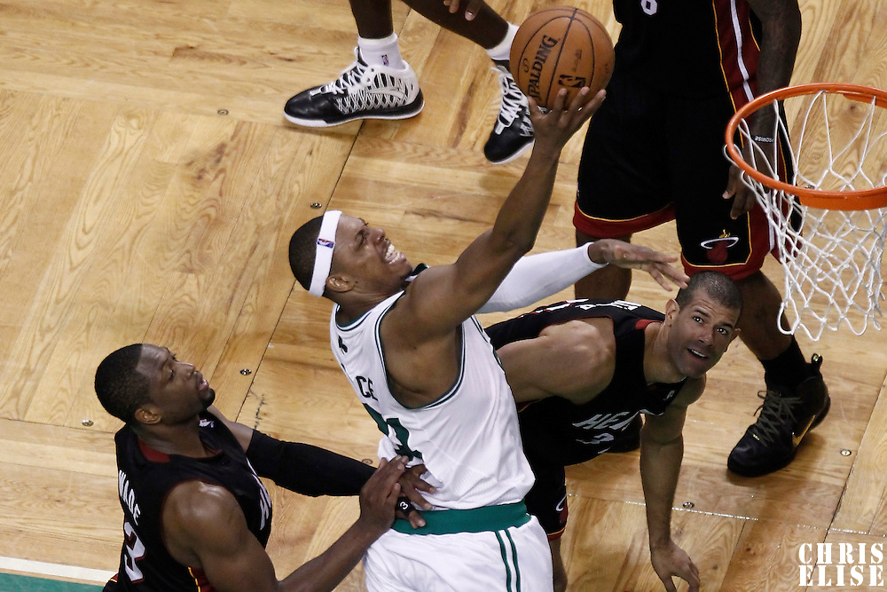 01 June 2012: Boston Celtics small forward Paul Pierce (34) goes for the layup in the traffic during the Boston Celtics 101-91 victory over the Miami Heat, in Game 3 of the Eastern Conference Finals playoff series, at the TD Banknorth Garden, Boston, Massachusetts, USA.
