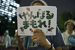 "September 28, 2016 - Tokyo, Tokyo, Japan - Protestor has a sign reads ""Protect the forest"" during the demonstration against the construction of a new U.S. military base in Okinawa. The Executive Committee Stop Henoko organized the demonstration as the Abe government continues to put pressure on Okinawa to allow the project to proceed. (Credit Image: © Alessandro Di Ciommo via ZUMA Wire)"