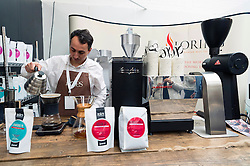 © Licensed to London News Pictures. 07/04/2016. A coffee barista making coffee on a stand at The London Coffee Festival. Now its 4th year, will attract over 35,00 visitors over the four day event. London, UK. Photo credit: Ray Tang/LNP