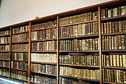 Old books on the shelves of the Joanina Library (Biblioteca Joanina) in Coimbra University, Coimbra, Portugal