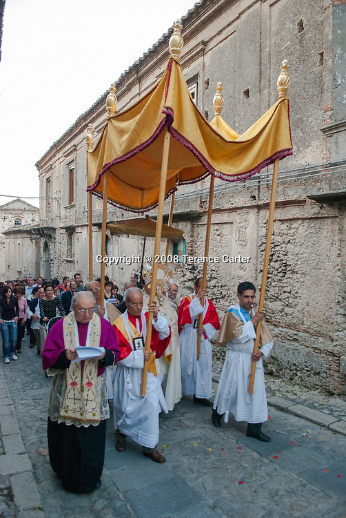 A religious festival procession winds its way thought the streets of Gerace.