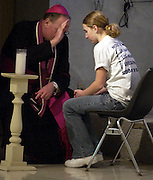 Archbishop Dolan listens to a young adult's penance during a youth rally in 2003. (Sam Lucero photo)