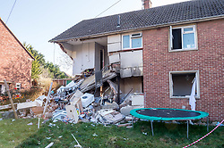 © Licensed to London News Pictures. 24/02/2019. Bristol, UK. A house explosion in Whitchurch Lane, Hartcliffe. Three people received minor injuries and were taken to hospital and much of the house was destroyed. A large trampoline was used to help some people escape. It is reported that it may have been a gas boiler explosion. Photo credit: Simon Chapman/LNP