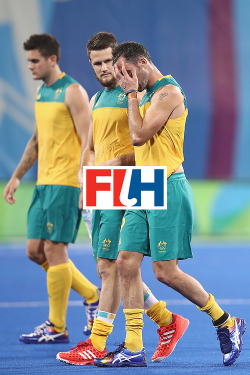 RIO DE JANEIRO, BRAZIL - AUGUST 07:  Matt Gohdes and Mark Knowles of Australia look dejected after defeat during the men's pool A match between Spain and Australia on Day 2 of the Rio 2016 Olympic Games at the Olympic Hockey Centre on August 7, 2016 in Rio de Janeiro, Brazil.  (Photo by Mark Kolbe/Getty Images)