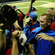 The Clarinda A's celebrate their tournament victory over Omaha in July.  photo by David Peterson