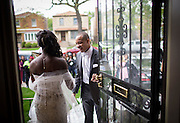 Daniel Jackson opens the door for his date Nailah Bradley as they step out for their prom send-off party at her South Shore home Saturday, May 17, 2014. (Brian Cassella/Chicago Tribune) B583716572Z.1  ....OUTSIDE TRIBUNE CO.- NO MAGS,  NO SALES, NO INTERNET, NO TV, CHICAGO OUT, NO DIGITAL MANIPULATION...