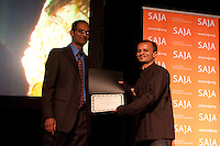 Sandip Roy of New America Media (right) collects one of his two SAJA Awards from SAJA President Sandeep Junnarkar