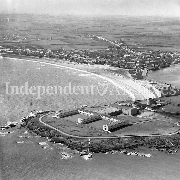 A347 Red Island Holiday Camp, Skerries.  <br /> (Part of the Independent Newspapers Ireland/NLI collection.)<br /> These aerial views of Ireland from the Morgan Collection were taken during the mid-1950's, comprising medium and low altitude black-and-white birds-eye views of places and events, many of which were commissioned by clients. From 1951 to 1958 a different aerial picture was published each Friday in the Irish Independent in a series called, 'Views from the Air'.The photographer was Alexander 'Monkey' Campbell Morgan (1919-1958). Born in London and part of the Royal Artillery Air Corps, on leaving the army he started Aerophotos in Ireland. He was killed when, on business, his plane crashed flying from Shannon.
