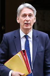 "© Licensed to London News Pictures. 20/03/2019. London, UK. Philip Hammond - Chancellor of the Exchequer departs from Number 11 Downing Street to attend Prime Minister's Questions (PMQs) in the House of Commons. According to No 10 Downing Street, later today Theresa May will write to European Union chiefs requesting a ""short"" delay to the date Britain leaves the EU. Photo credit: Dinendra Haria/LNP"