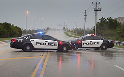 September 9, 2017 - Hollywood, FL, United States - Police block a road leading to the ocean front as Hurricane Irma makes landfall in Hollywood, Fla., Saturday, September 9, 2017. THE CANADIAN PRESS/Paul Chiasson (Credit Image: © Paul Chiasson/The Canadian Press via ZUMA Press)