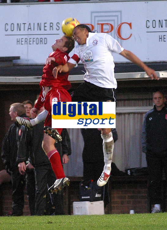 Photo: Dave Linney.<br />Hereford United v Walsall. Coca Cola League 2. 18/11/2006.Walsall's  Martin Butler (L) goes head to head with Tamika Mkandawire.