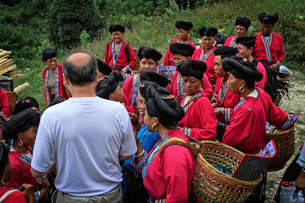 Tribal Zhuang women meet a western man.