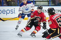 PENTICTON, CANADA - SEPTEMBER 17: Brayden Burke #94 of Calgary Flames stops on the ice against the Edmonton Oilers on September 17, 2016 at the South Okanagan Event Centre in Penticton, British Columbia, Canada.  (Photo by Marissa Baecker/Shoot the Breeze)  *** Local Caption *** Brayden Burke;