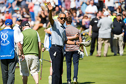Former US president Barack Obama playing the 18th green, at St Andrews Links golf course, Scotland