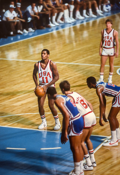 CARACAS, VENEZUELA -  AUGUST 1983:  Fred Reynolds #11 (USA) attempts a free throw during the 1983 Pan Am Games basketball tournament held from August 15-27, 1983 in Caracas, Venezuela.  The USA team was the gold medalist in the event.  Visible in background is Mark Price #10 (USA).  (Photo by David Madison/Getty Images) *** Local Caption *** Fred Reynolds