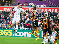 Football - 2016 / 2017 Premier League - Swansea City vs. Hull City<br /> <br /> Ki Sung-Yeung of Swansea City heads at goal in the dying minutes -- at the Liberty Stadium.<br /> <br /> COLORSPORT/WINSTON BYNORTH