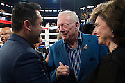 Oscar De La Hoya visits with Dallas Cowboys owner Jerry Jones and his wife, Eugenia Jones, after Canelo Alvarez defeated Liam Smith in front of over 51,000 fans at AT&T Stadium in Arlington, Texas on September 17, 2016.  (Cooper Neill for ESPN)