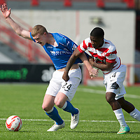 Hamilton Academical St Johnstone....04.04.15<br /> Brian Easton is fouled by Nigel Hasselbaink<br /> Picture by Graeme Hart.<br /> Copyright Perthshire Picture Agency<br /> Tel: 01738 623350  Mobile: 07990 594431