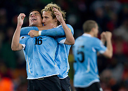 Maximiliano Pereira of Uruguay and Diego Forlan of Uruguay celebrate after goal  during penalty shots at the  2010 FIFA World Cup South Africa Quarter Finals football match between Uruguay and Ghana on July 02, 2010 at Soccer City Stadium in Sowetto, suburb of Johannesburg. Uruguay defeated Ghana after penalty shots. (Photo by Vid Ponikvar / Sportida)