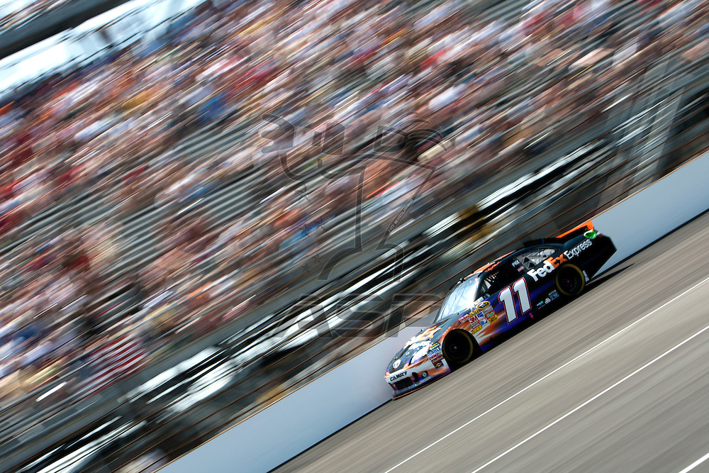 Speedway, IN  - JUL 31, 2011:  Denny Hamlin (11) races to turn one for the Brickyard 400 presented by BigMachineRecords.com at Indianapolis Motor Speedway in Speedway, IN.