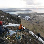 Andri Bjarnason and Freyr Ingi Björnsson at the top of the ice climb 55° at Búahamrar, Reykjavík, Iceland.