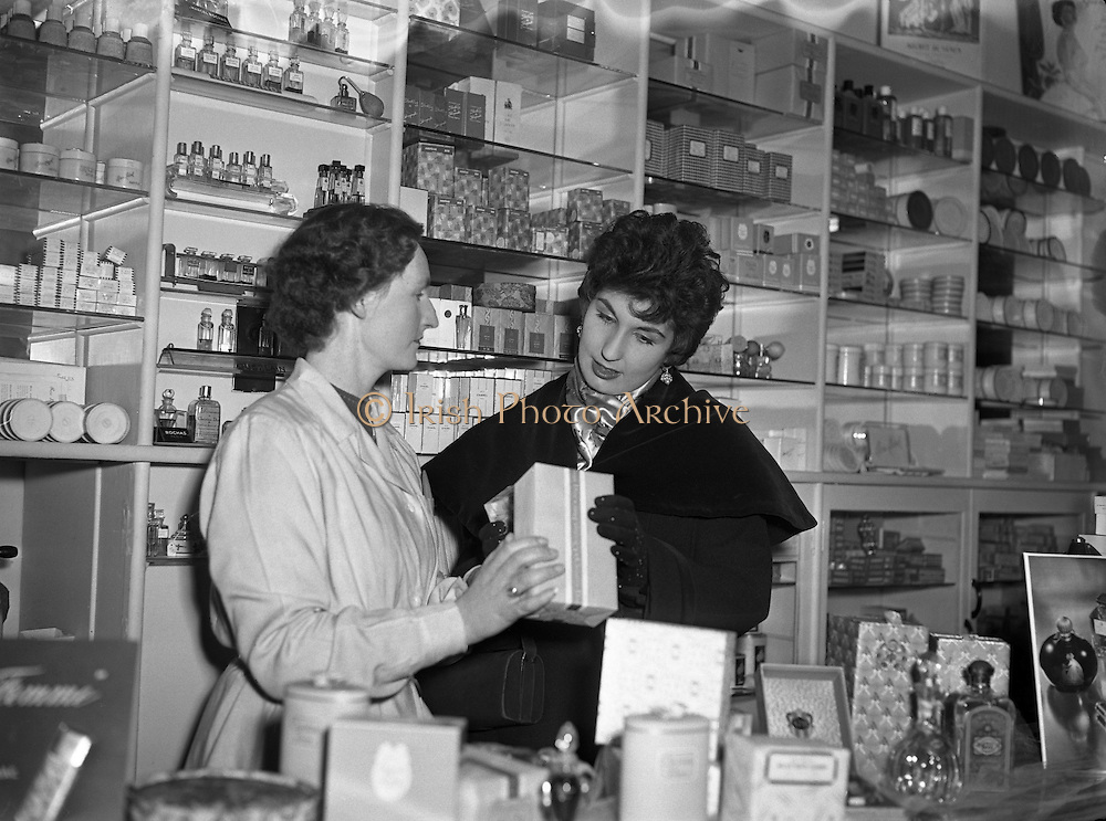 """Mr Eamon Andrews and Alma Cogan at Woulfes Pharmacy, Grafton St.01/12/1954..Alma Cogan (19/05/1932 – 26/10/1966) was an English singer of traditional pop music in the 1950s and early 1960s. Dubbed """"The Girl With the Laugh/Giggle/Chuckle In Her Voice"""", she was the highest paid British female entertainer of her era. Throughout the mid-1950s, she was the most consistently successful female singer in the UK."""