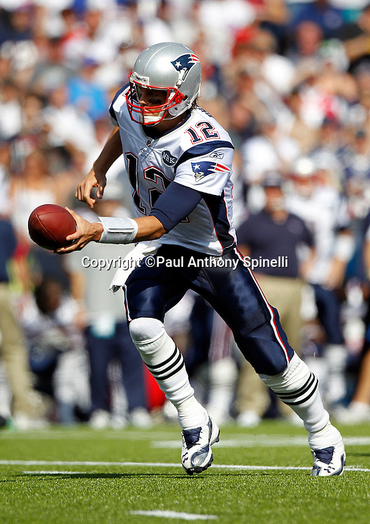 New England Patriots quarterback Tom Brady (12) hands off the ball on a running play during the NFL week 3 football game against the Buffalo Bills on Sunday, September 25, 2011 in Orchard Park, New York. The Bills won the game 34-31. ©Paul Anthony Spinelli