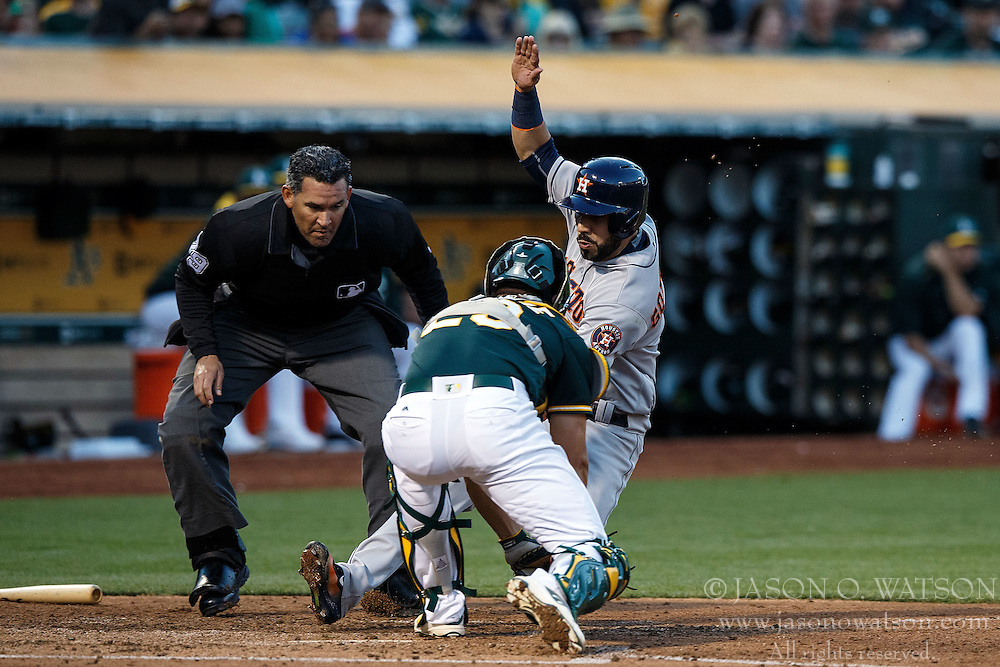 OAKLAND, CA - JULY 19:  Marwin Gonzalez #9 of the Houston Astros is tagged out at home plate by Matt McBride #29 of the Oakland Athletics in front of umpire Manny Gonzalez #79 during the third inning at the Oakland Coliseum on July 19, 2016 in Oakland, California. The Oakland Athletics defeated the Houston Astros 4-3 in 10 innings.  (Photo by Jason O. Watson/Getty Images) *** Local Caption *** Marwin Gonzalez; Matt McBride; Manny Gonzalez