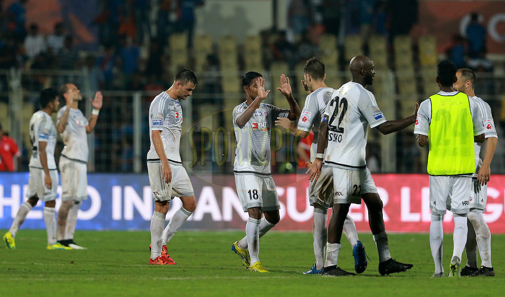 FC Pune City players celebrates after winning the match 8 of the Indian Super League (ISL) season 3 between FC Goa and FC Pune City held at the Fatorda Stadium in Goa, India on the 8th October 2016.<br /> <br /> Photo by Vipin Pawar / ISL/ SPORTZPICS